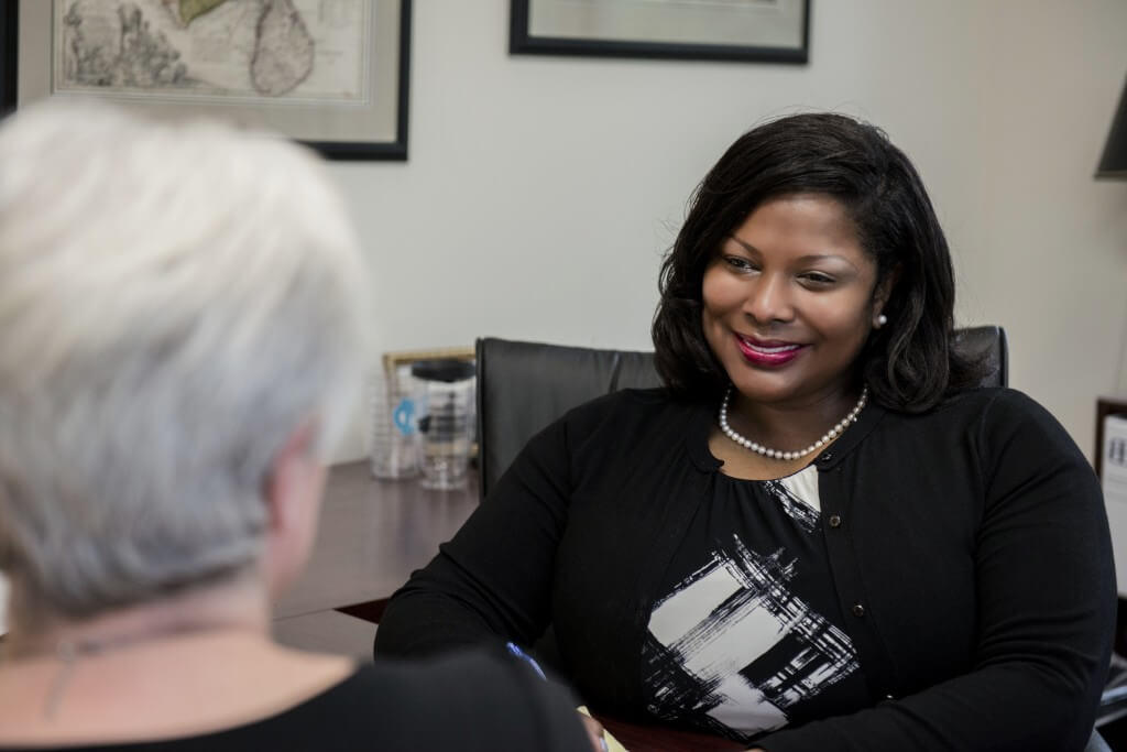 Janelle Lyons - Cranfill Sumner & Hartzog attorney, meets with client