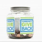 "Jar of pennies with ""Community Give Back"" Printed on the side"