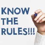 "Stock Photo of Hand Writing ""Know the Rules"""