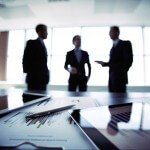 Blurred photo of businessmen meeting