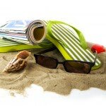 Sunglasses, Flip Flops, Magazine & Seashell in the Sand